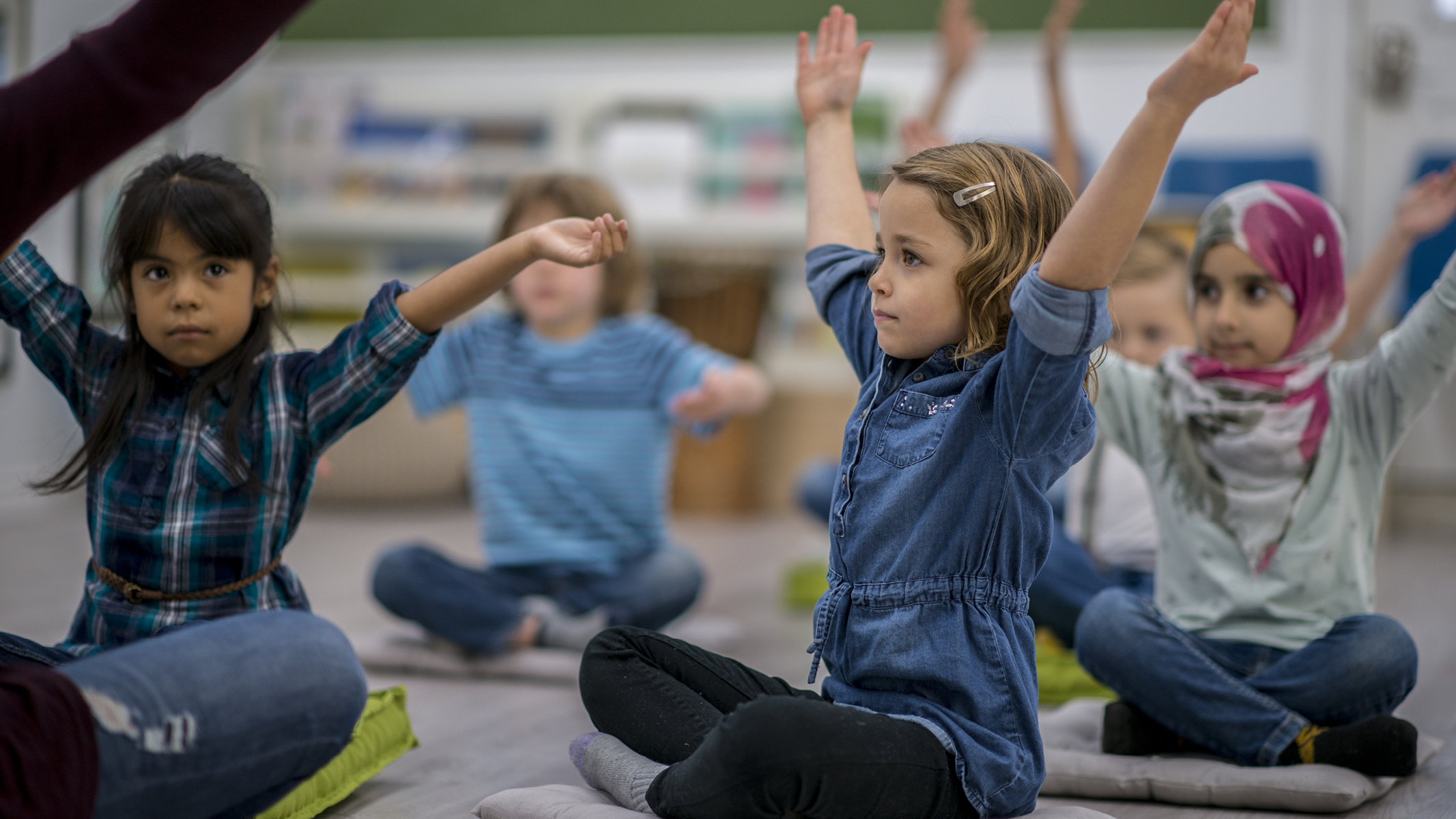 Kids stretching in classroom-Sanford fit