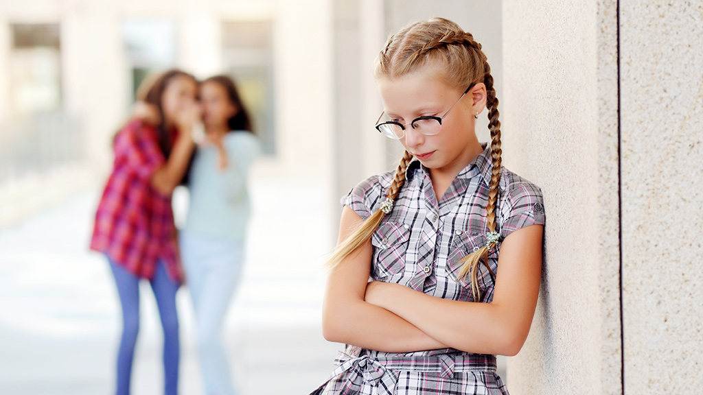 Young girl appearing sad with girls laughing in the background-Sanford Fit