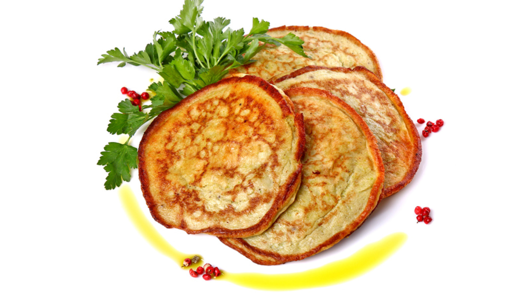 Stack of pancakes with leaf garnish - Sanford fit
