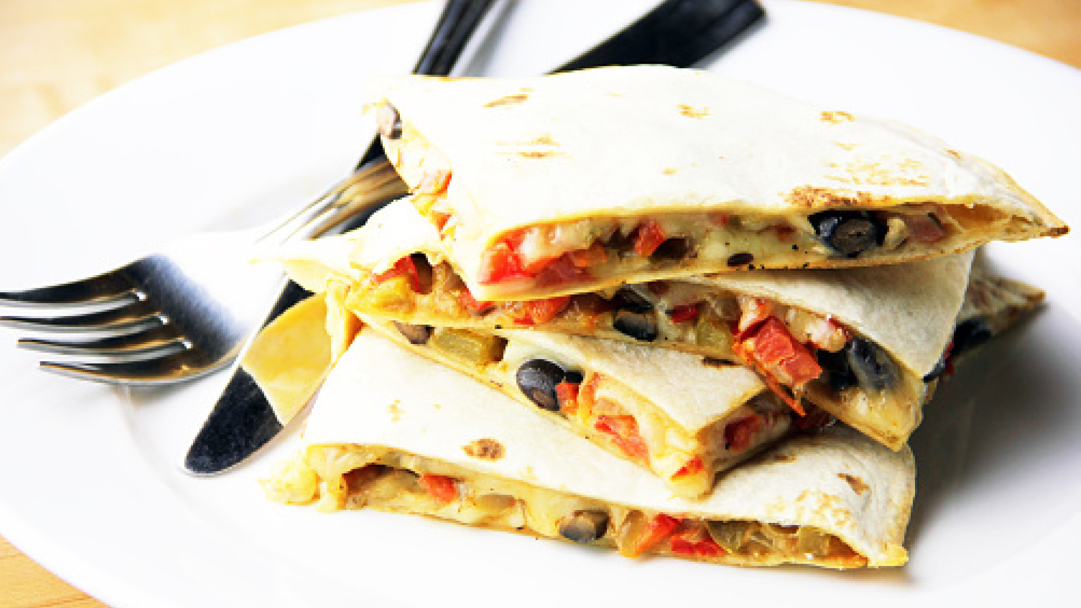 Black Bean Quesadilla on white plate with silverware - Sanford fit