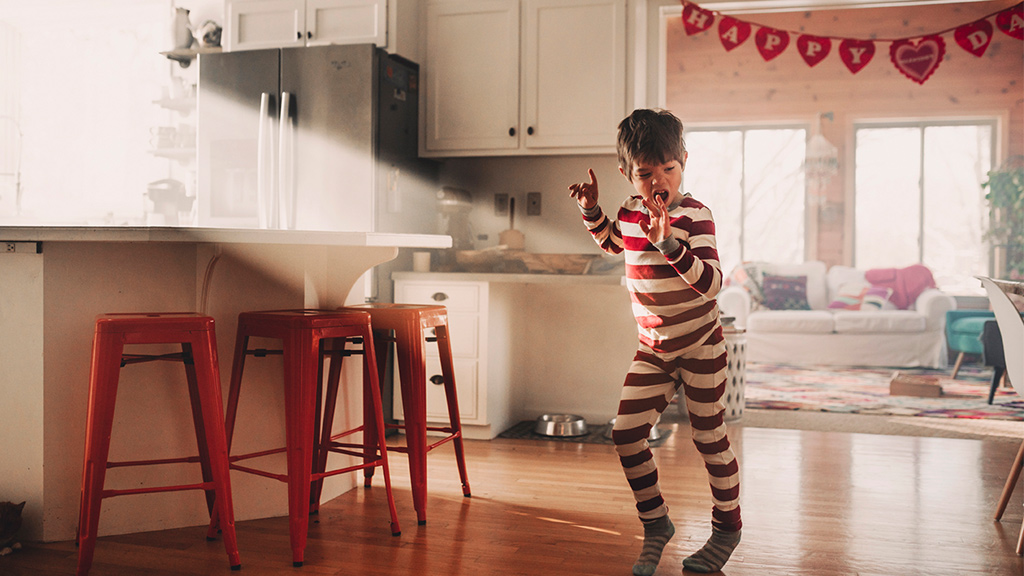 young boy dancing in kitchen-Sanford fit