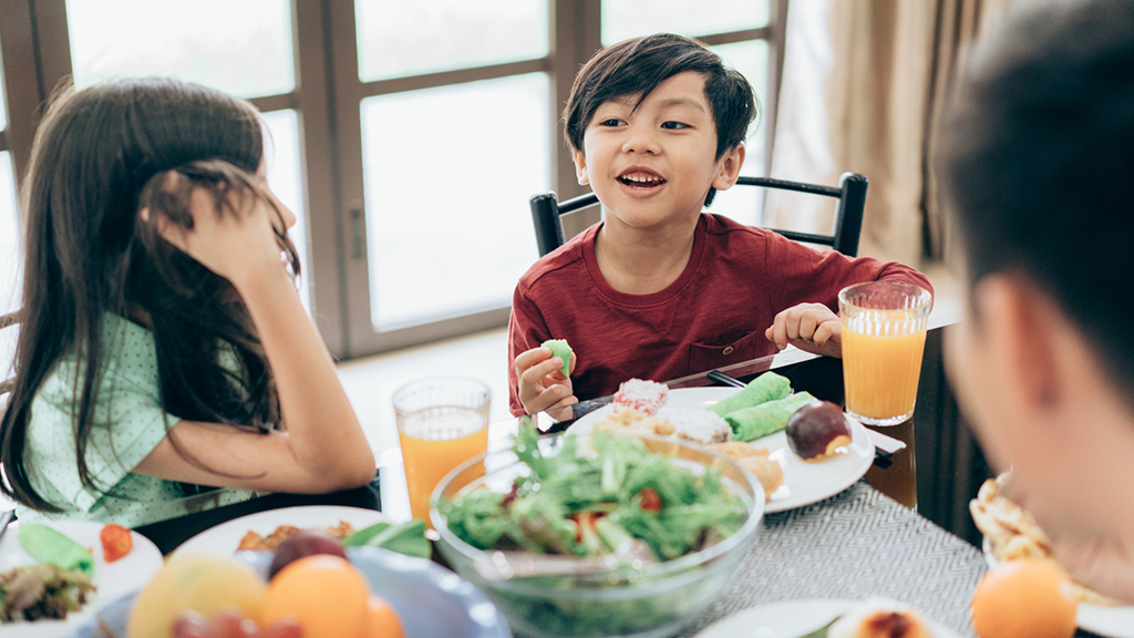 Family eating healthy meal together - Sanford fit
