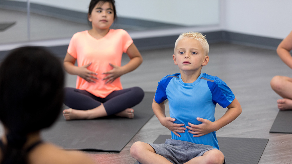 Little boy practices mindful breathing