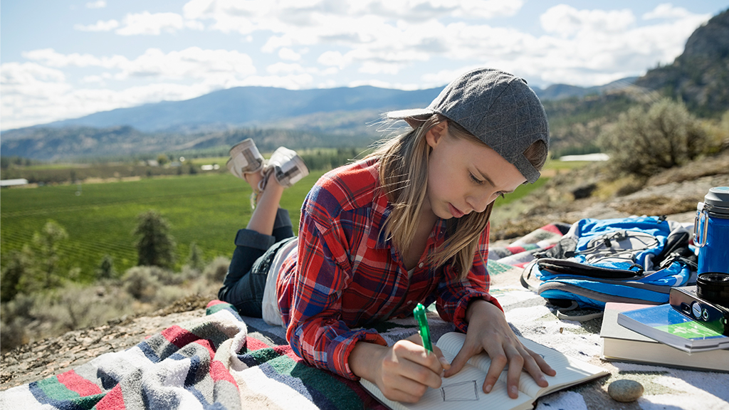 Girl drawing while in a field - Sanford fit