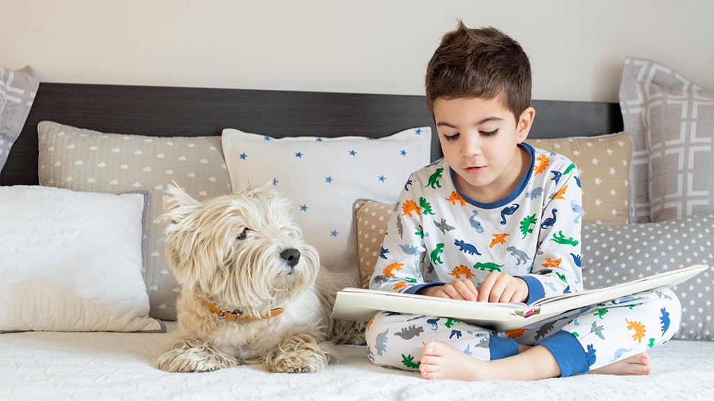 boys reads to his dog