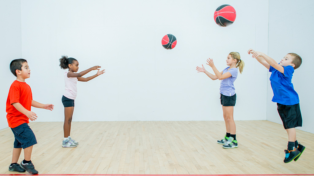 Kids tossing balls for goal setting activity