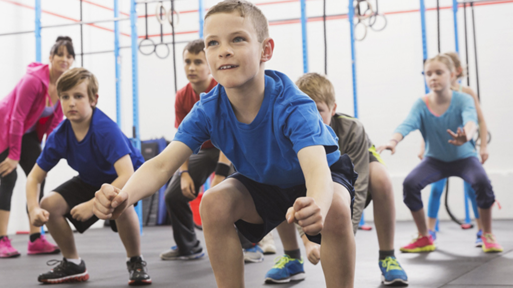 Children squatting and stretching - Sanford fit