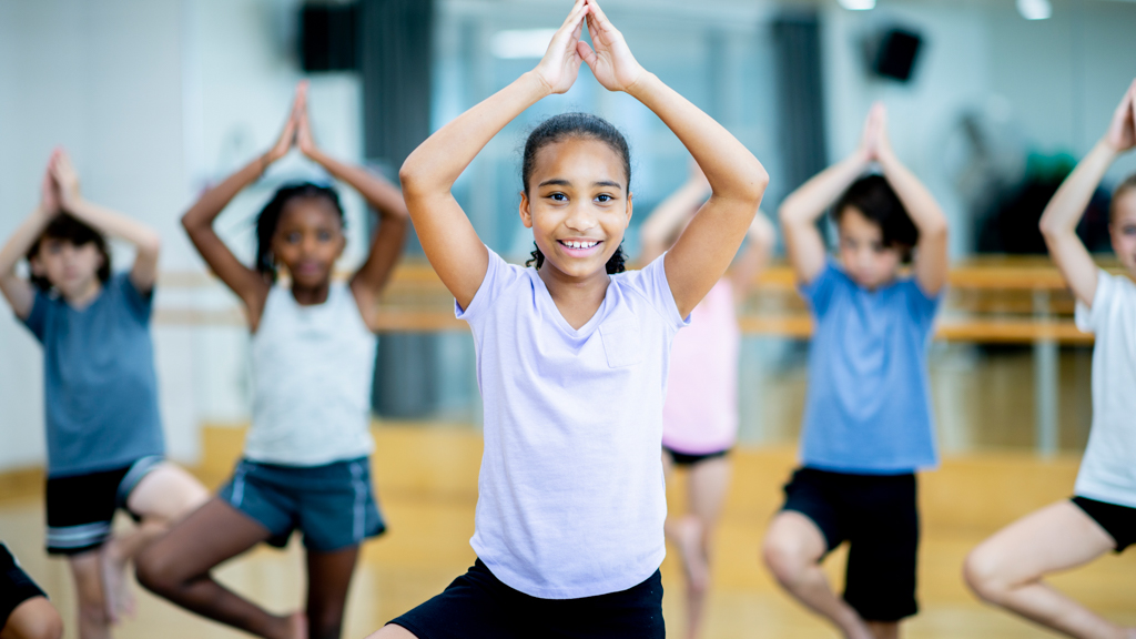 Children practicing tree pose yoga - Sanford fit