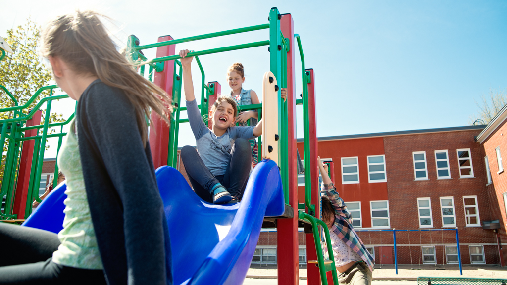 Kids playing on slide at school - Sanford fit