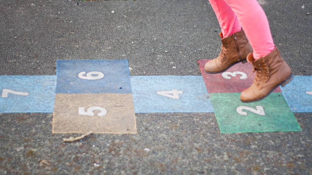 Child playing hopscotch - Sanford fit