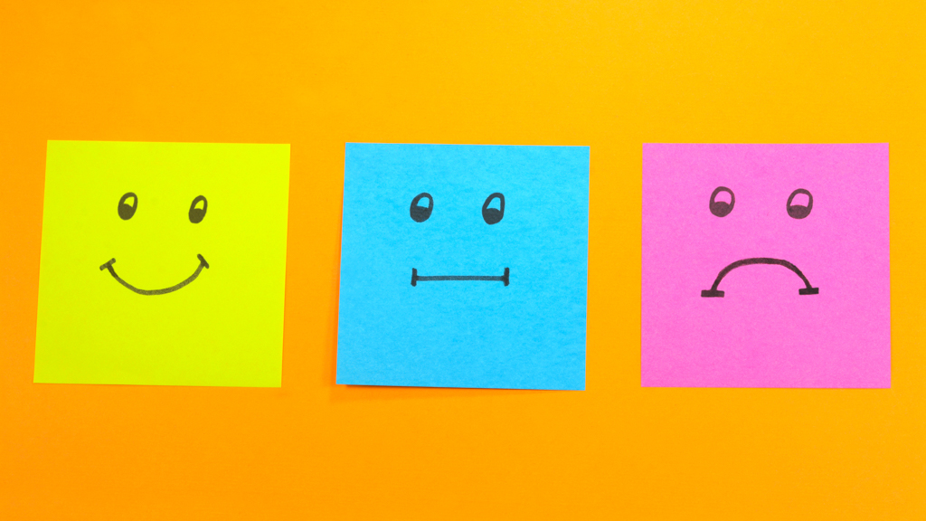 Stick notes with different smiley faces drawn - Sanford fit