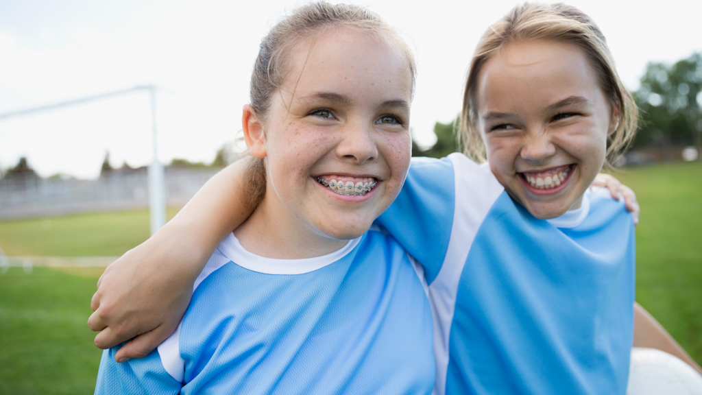 Two children smiling on the soccer field - Sanford fit