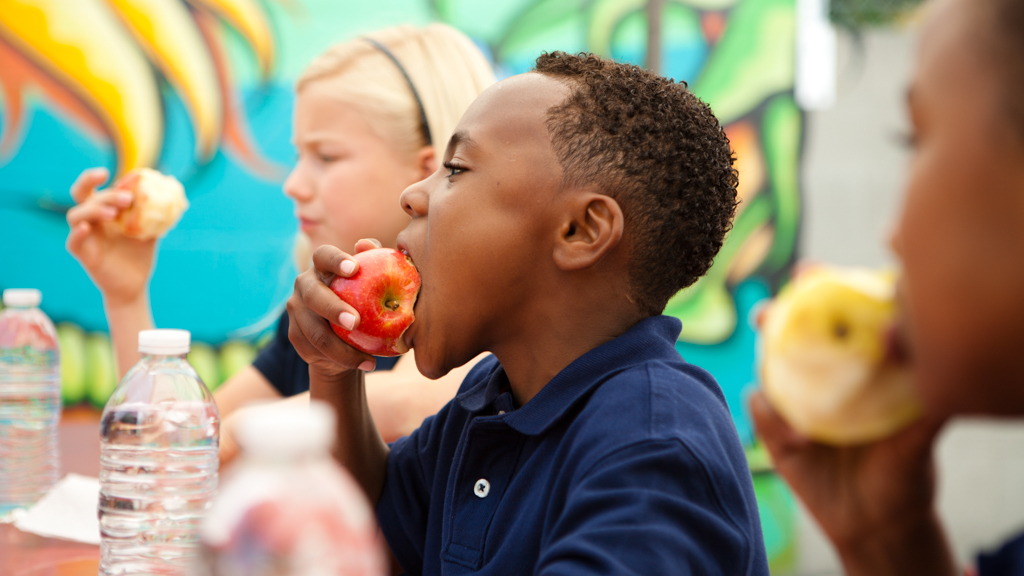 Children having apples and water outside - Sanford fit