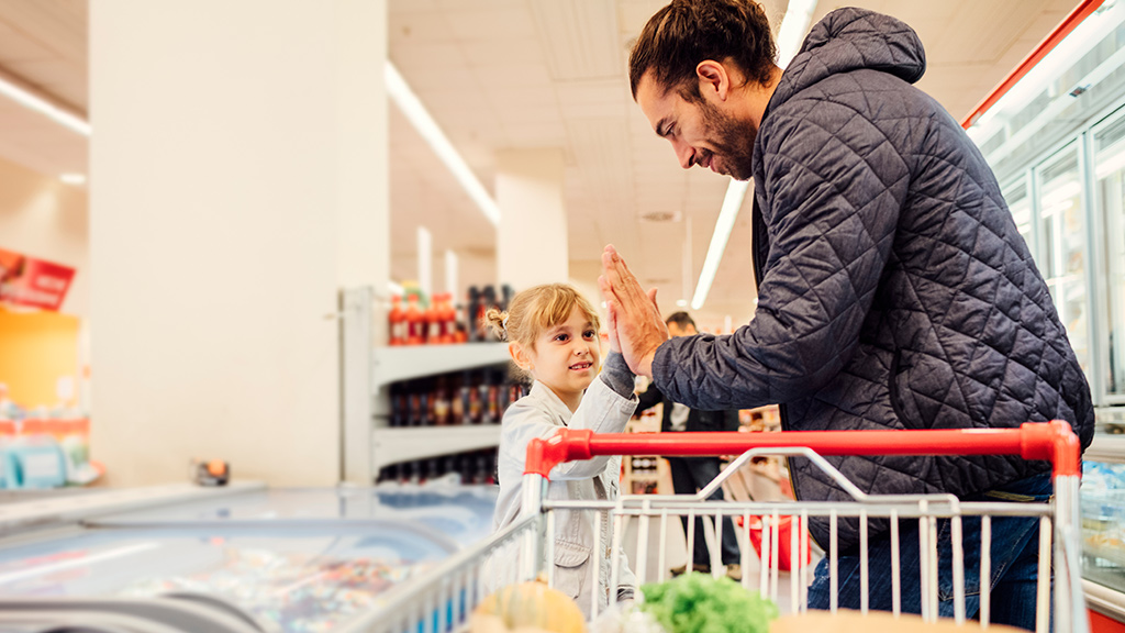 Parent and child choosing healthy foods while grocery shopping