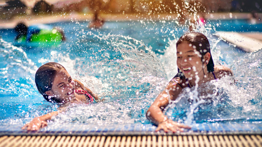 Children swimming outside - Sanford fit