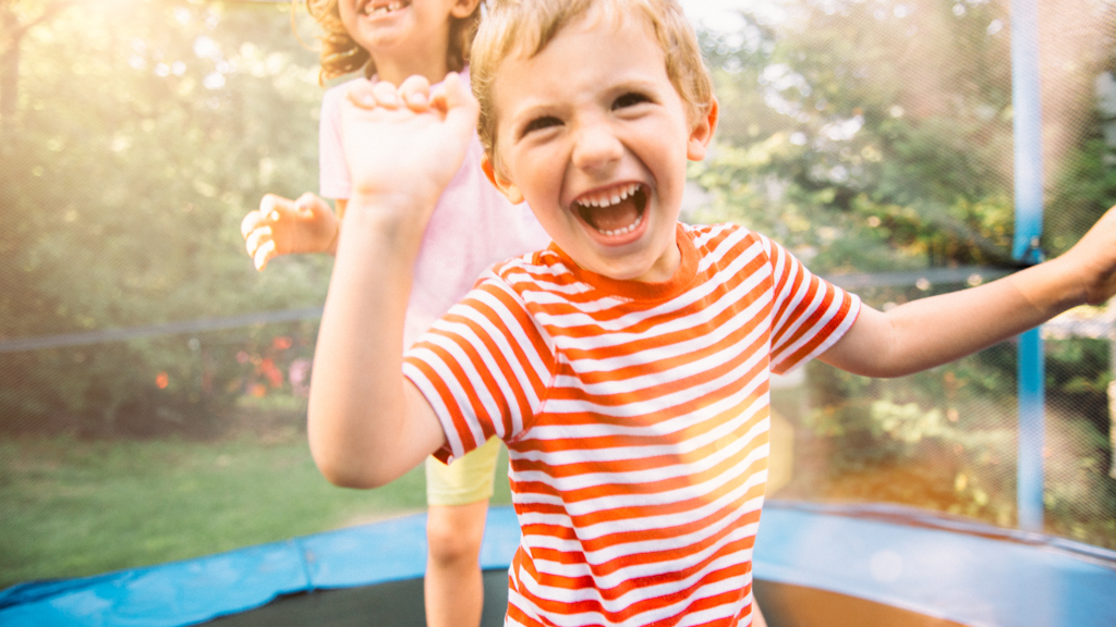 Children outside on a trampoline - Sanford fit