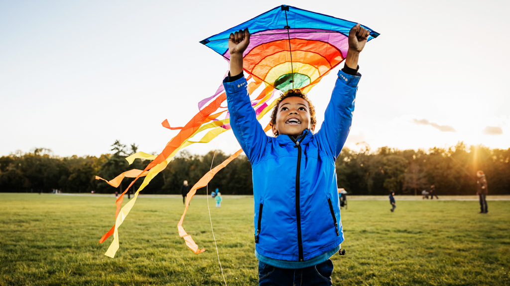 Child outside flying a kite - Sanford fit