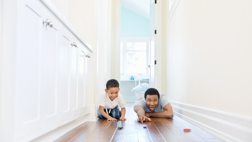 Parent and child playing with  toys in a hallway - Sanford fit
