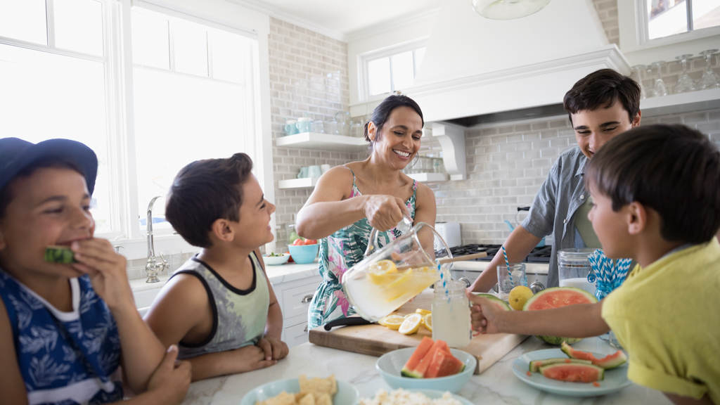 Parents and children in a kitchen eating - Sanford fit