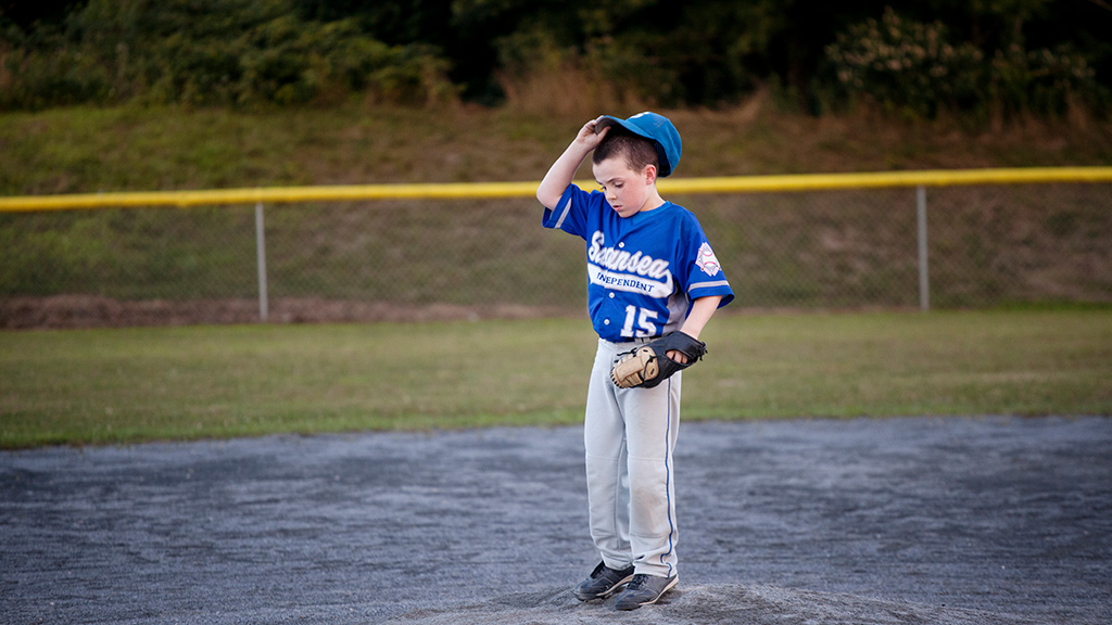 Baseball player standing alone on the field-Sanford Fit