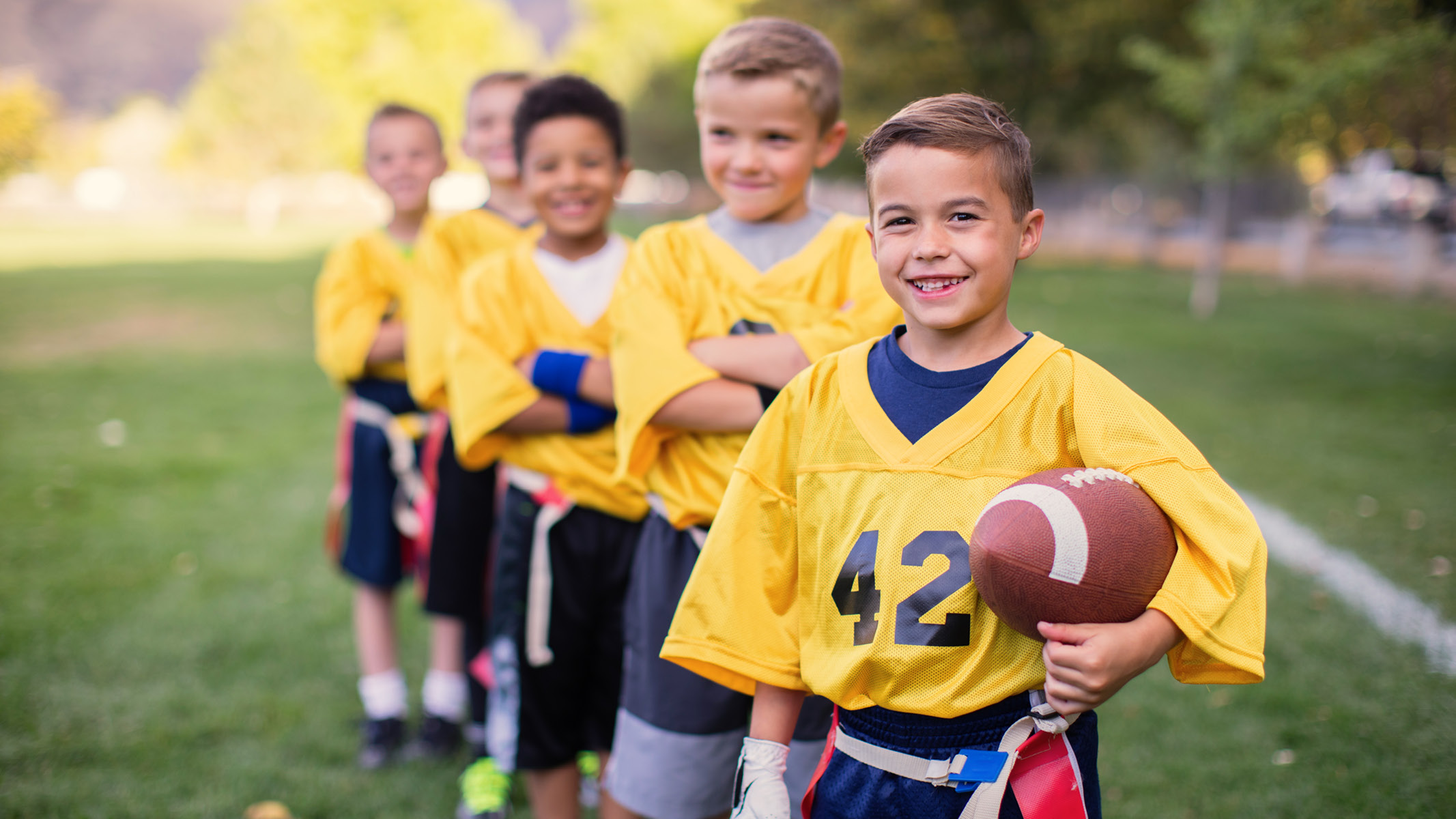 young football players standing on the field-Sanford Fit