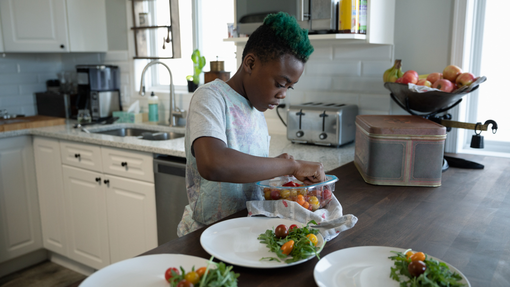 Child preparing healthy meals - Sanford fit